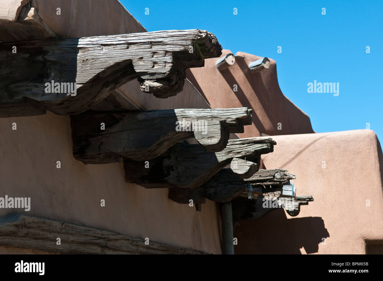 Wooden beams sticking out of Adobe building in Santa Fe New Mexico - Stock Image