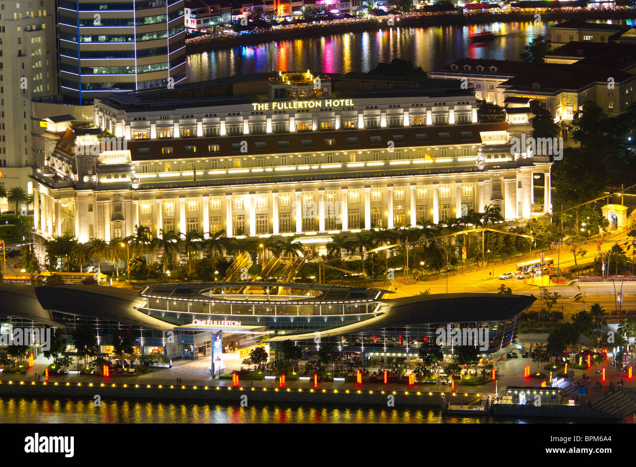 exterior of the Fullerton Hotel Singapore, at night - Stock Image