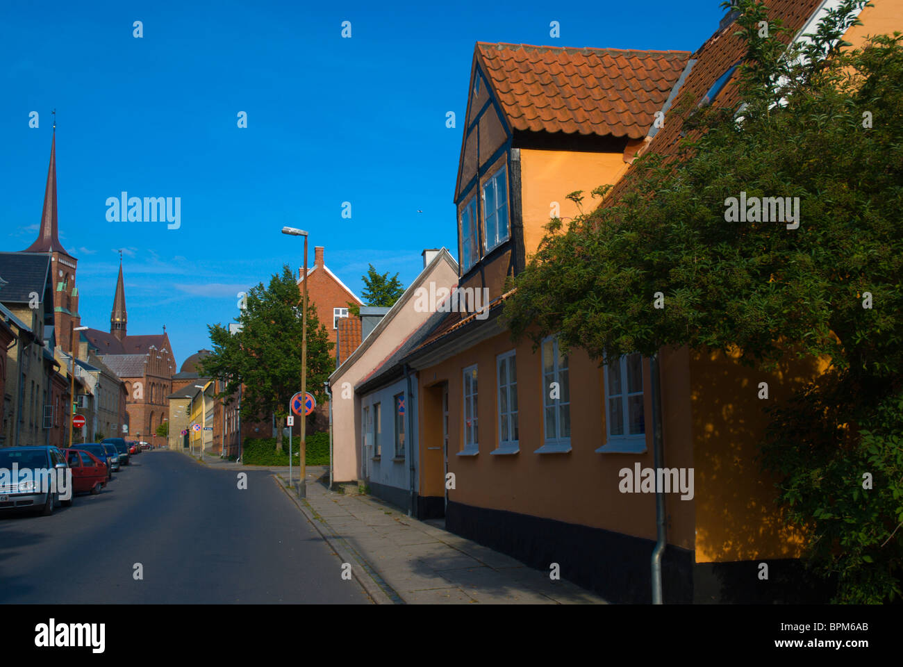 Residential houses and Domkirke cathedral Roskilde Denmark Europe - Stock Image