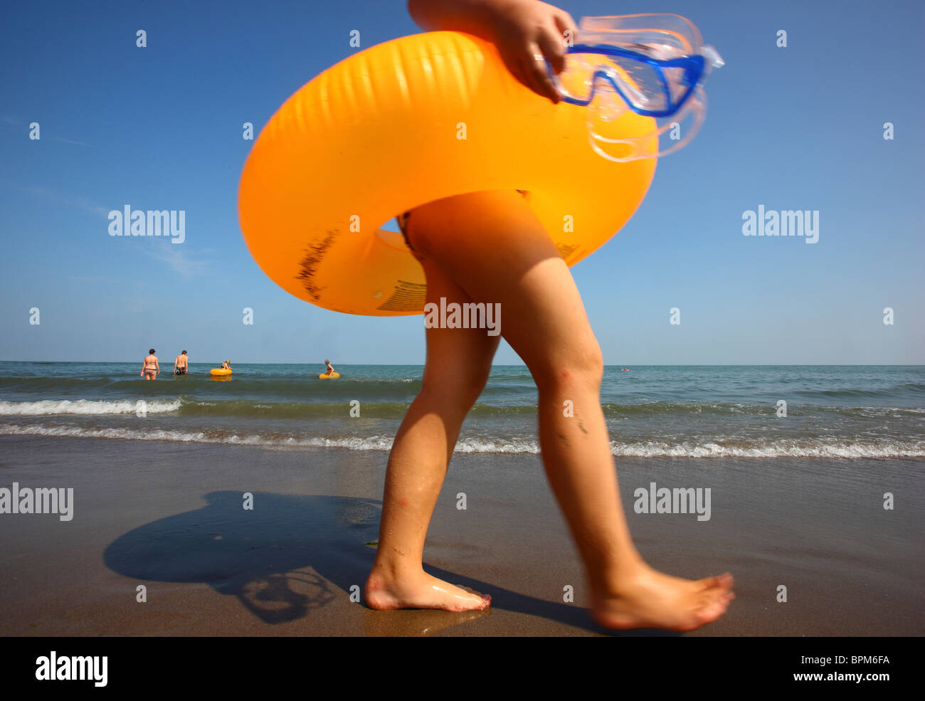 People on the beach at Jesolo, Adriatic sea, Italy. - Stock Image