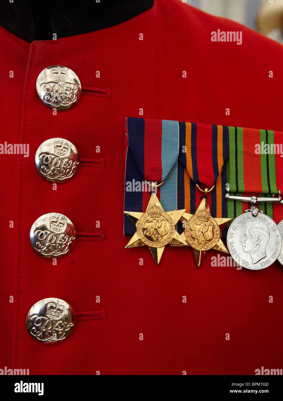 War Medals On The Red Tunic Of A Chelsea Pensioner Chelsea Flower Show London Europe - Stock Image