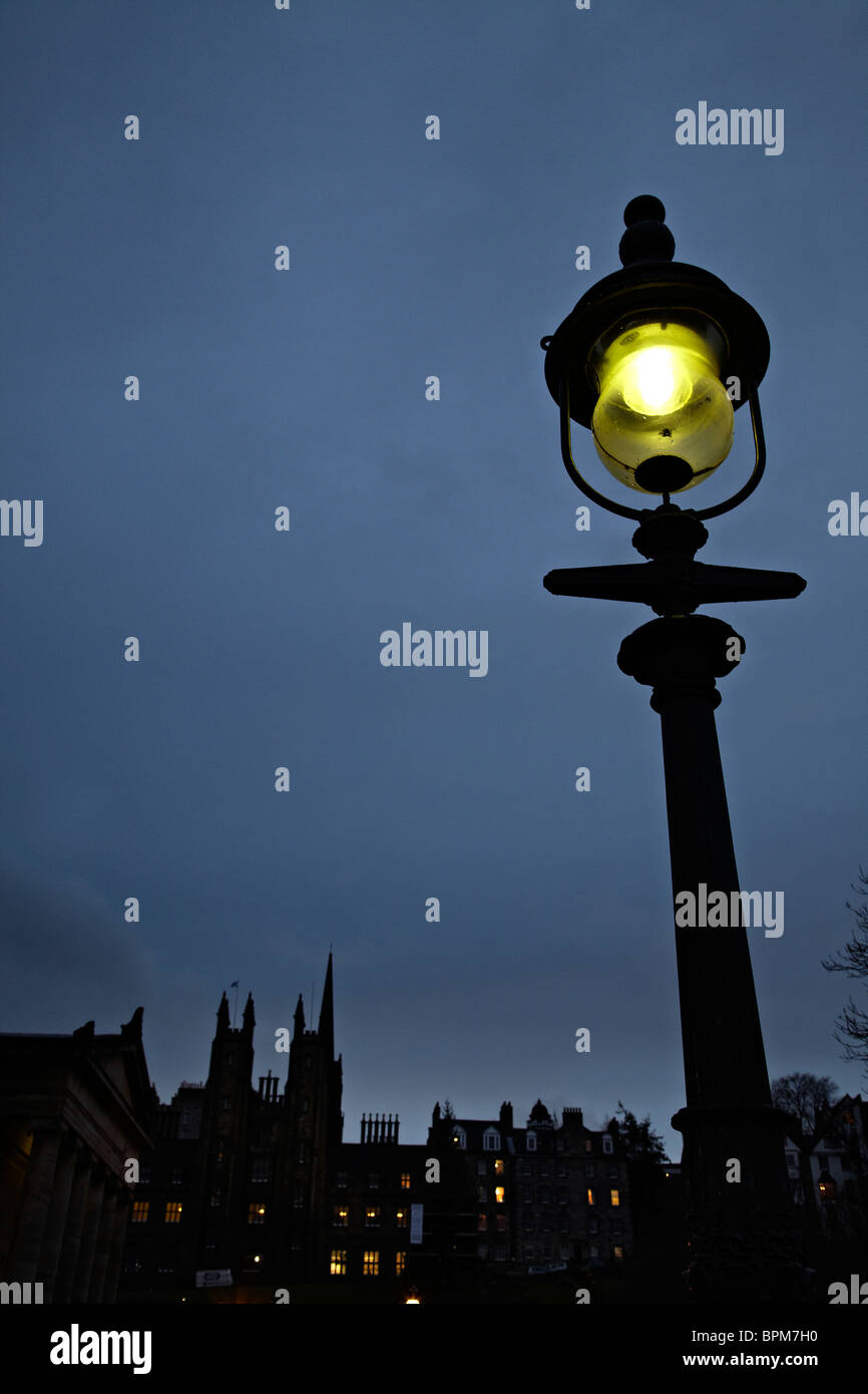 Streetlight and skyline of Edinburgh - Stock Image