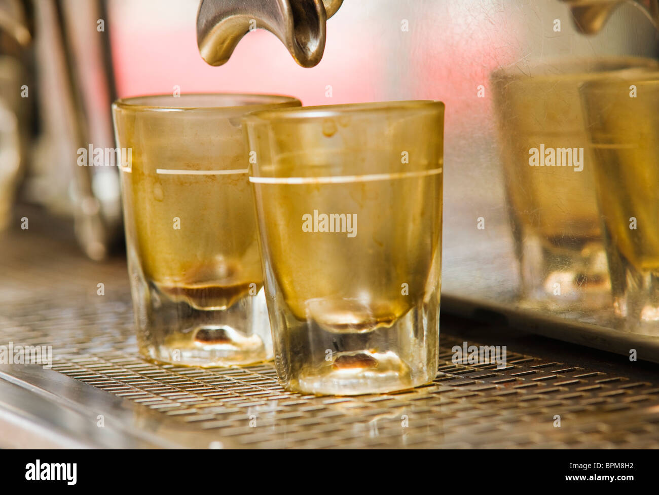 Two coffee stained shot glasses on an espresso machine. Seattle, WA - Stock Image