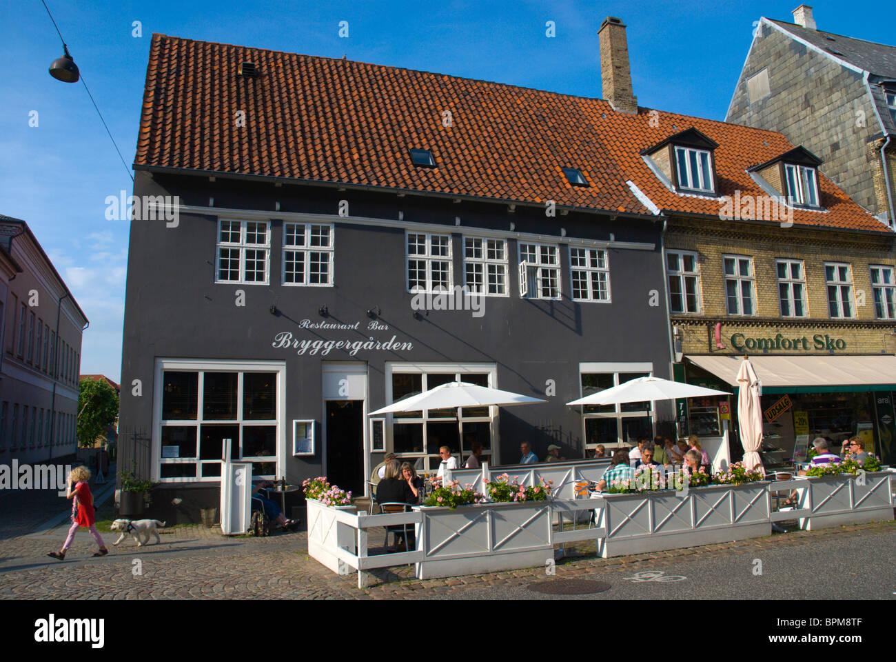 Restaurant terrace along Algade main pedestrian street Roskilde Denmark Europe - Stock Image