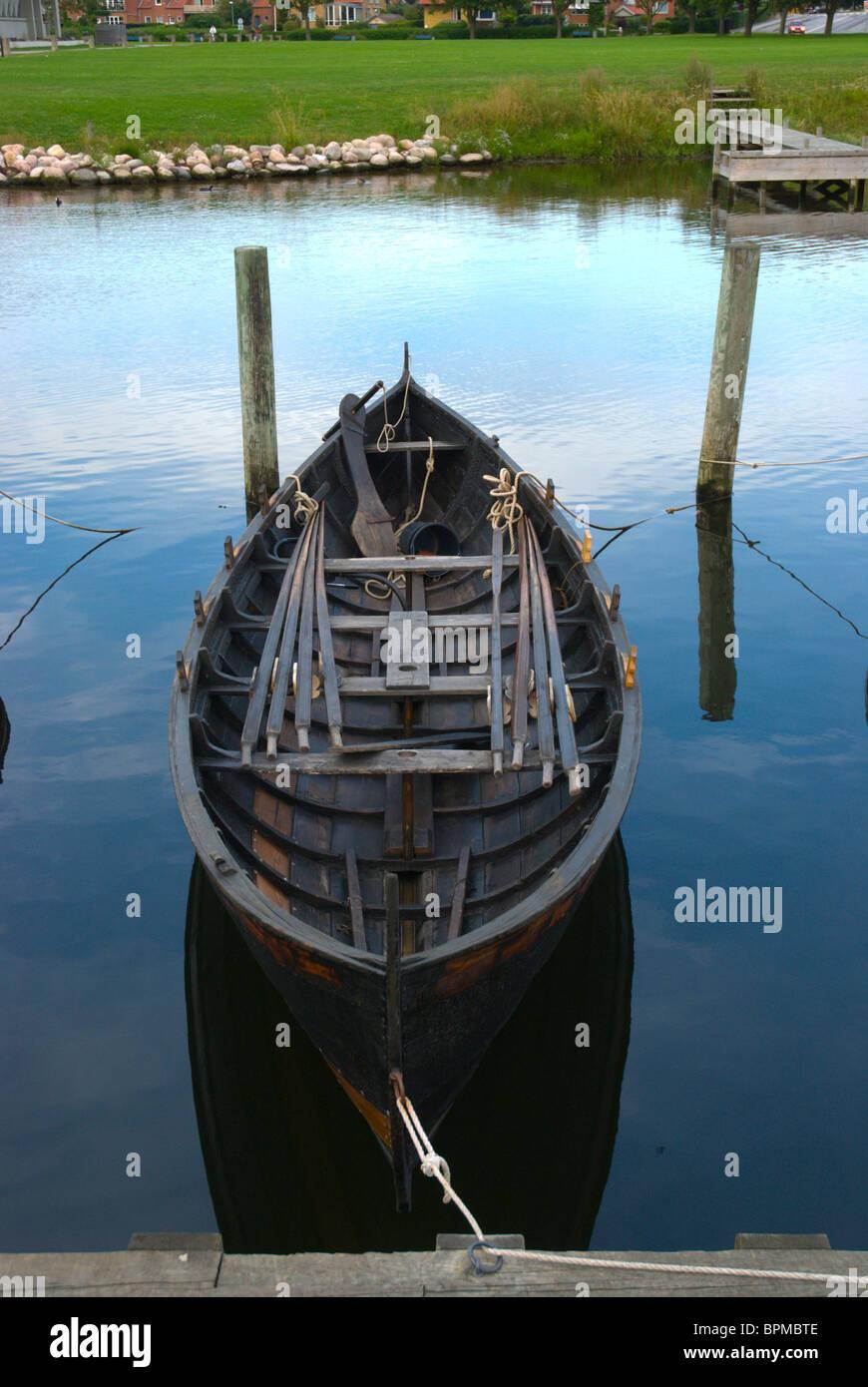 Replica of Krakan viking boat from Faroe island at Fjord of Roskilde Denmark Europe - Stock Image