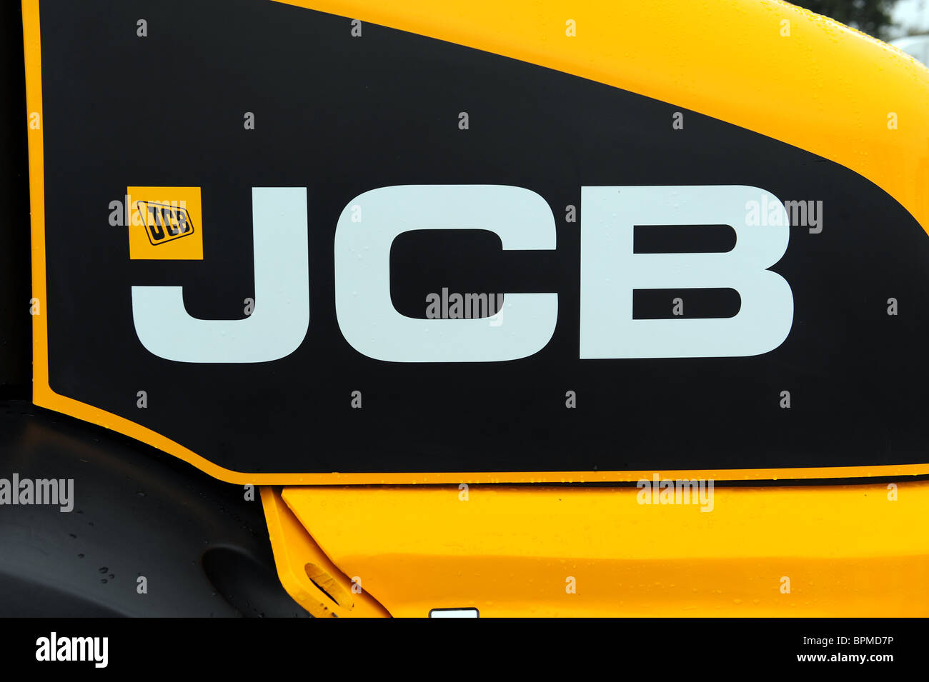 JCB logo on the side of a digger - Stock Image