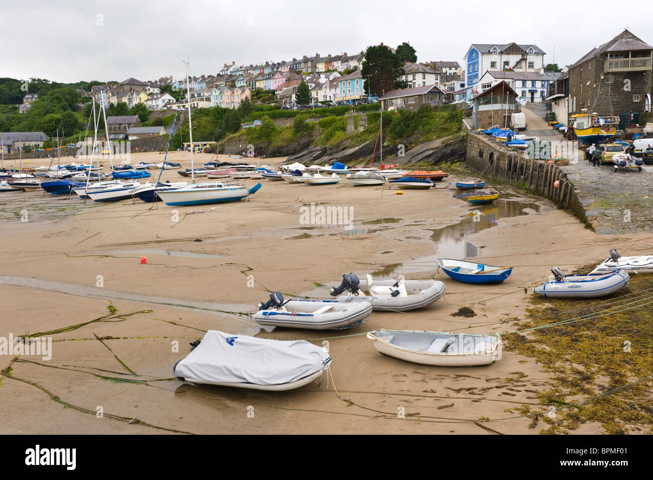 View over picturesque harbour in the Welsh seaside holiday resort of New Quay Ceredigion West Wales UK - Stock Image