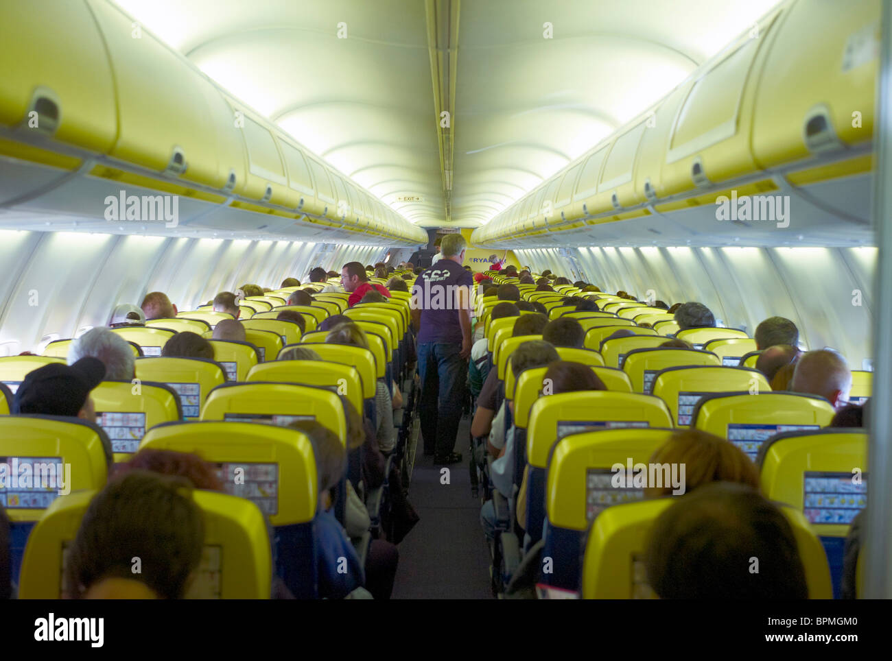 Passengers in the cabin of a Ryanair plane in flight - Stock Image