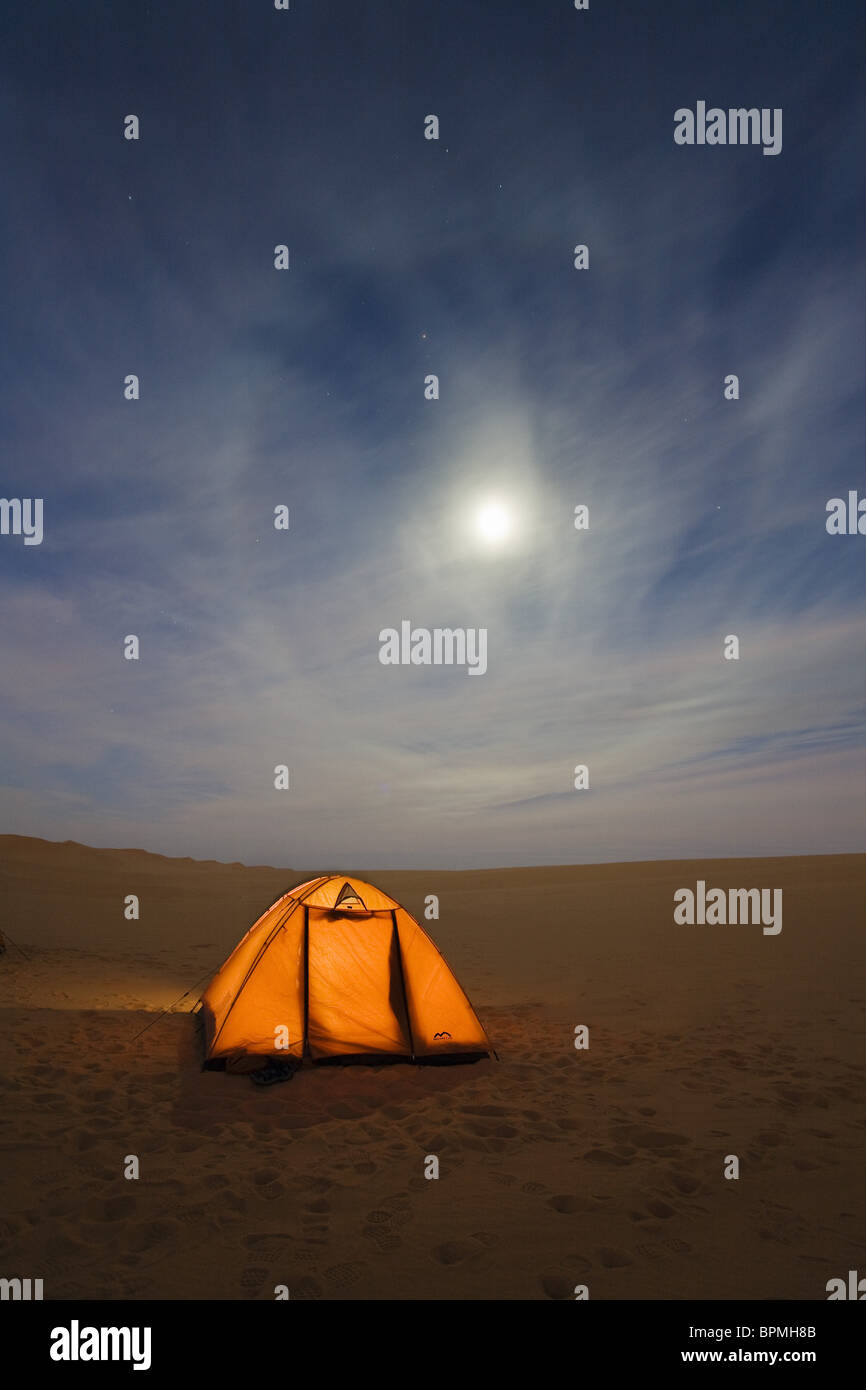 camping under the starry sky in the libyan desert, Moon Halo, Libya, Sahara, Africa - Stock Image