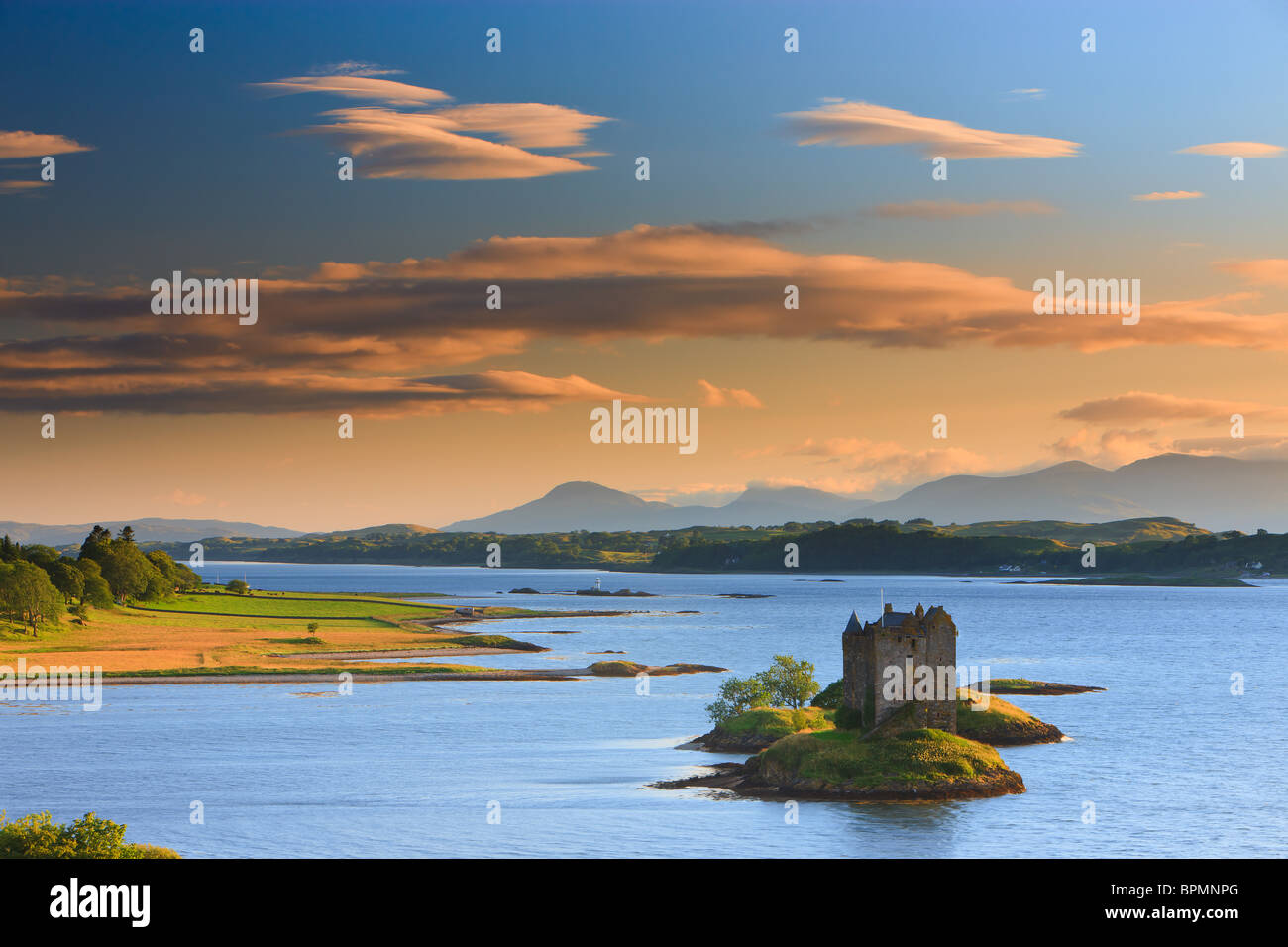 Castle Stalker is a four-storey tower house or keep picturesquely set on a tidal islet on Loch Laich, an inlet off Stock Photo