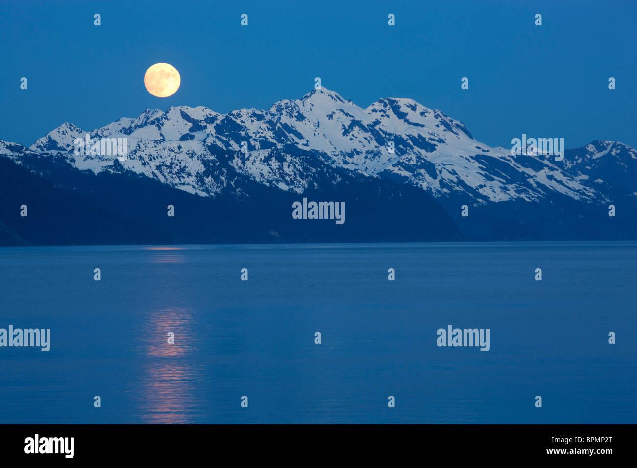 Full moon over Resurrection Bay, Seward, Alaska. - Stock Image