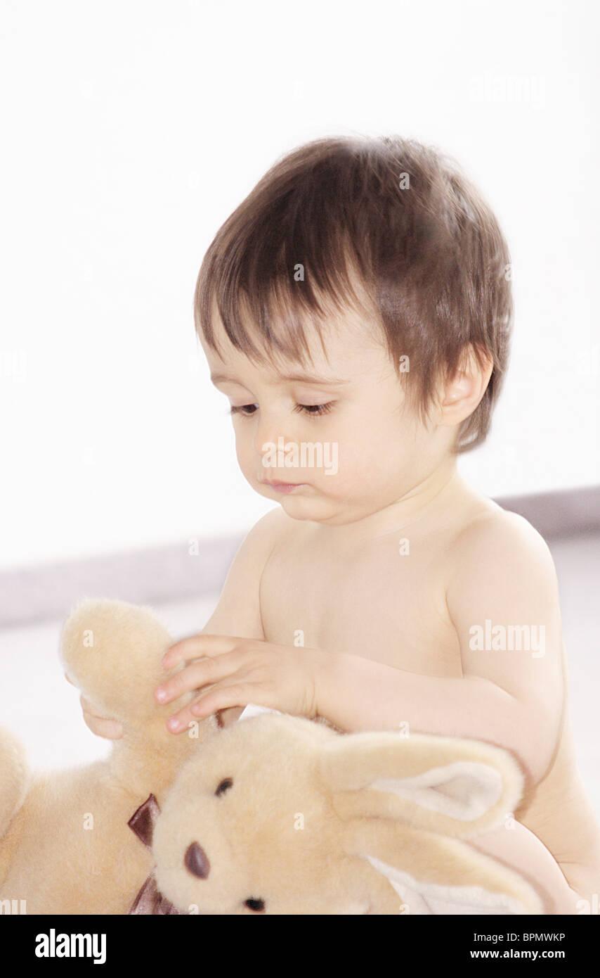 Little boy with rabbit Stock Photo