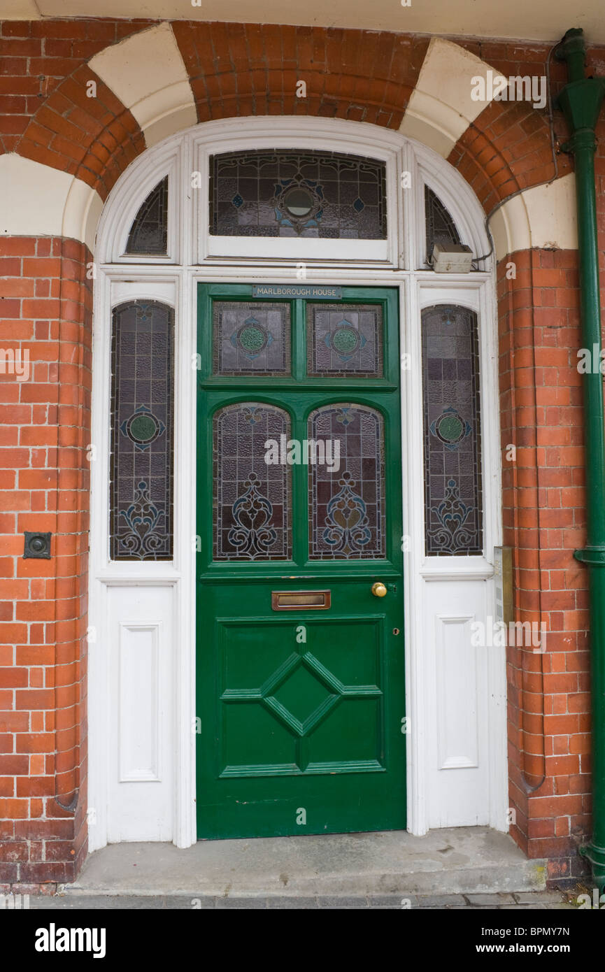 Victorian paneled green painted front door with stained glass of ...
