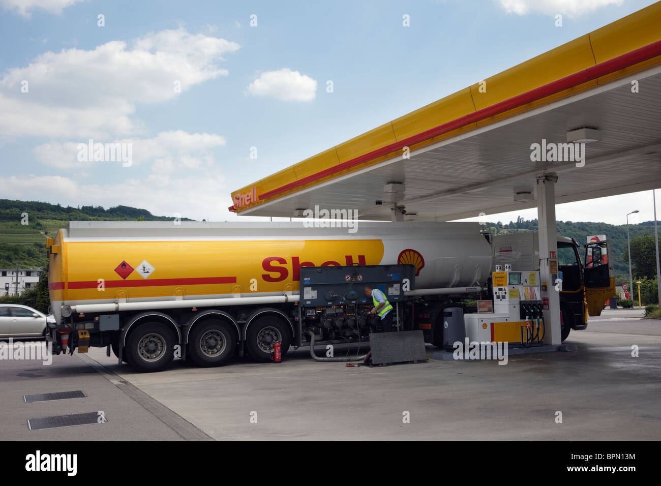 Luxembourg, Europe. Shell oil tanker delivering petrol to a filling station - Stock Image