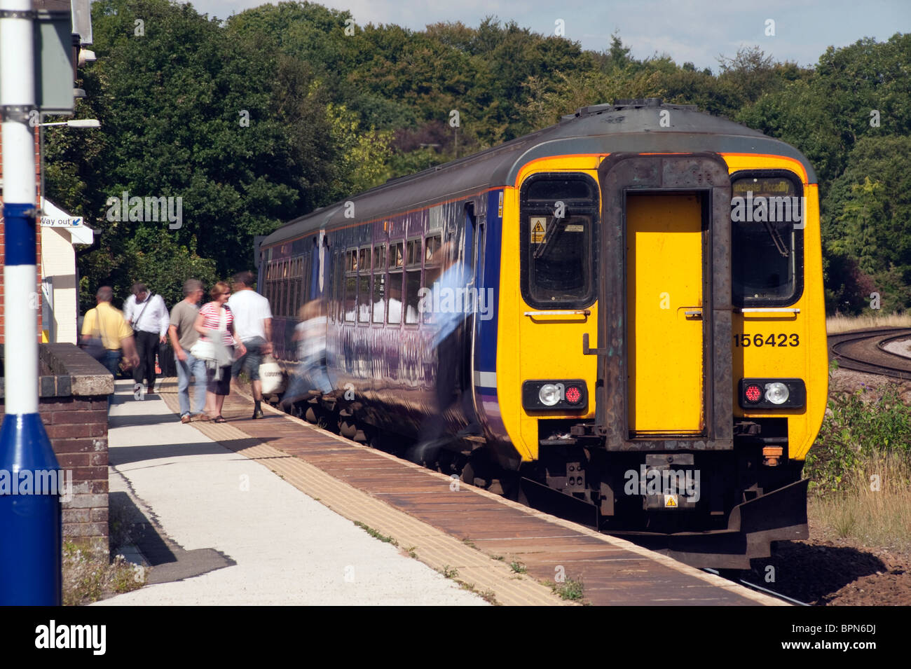 Train passengers leaving and boarding a train at Dore and Totley railway station on the Northern Line - Stock Image