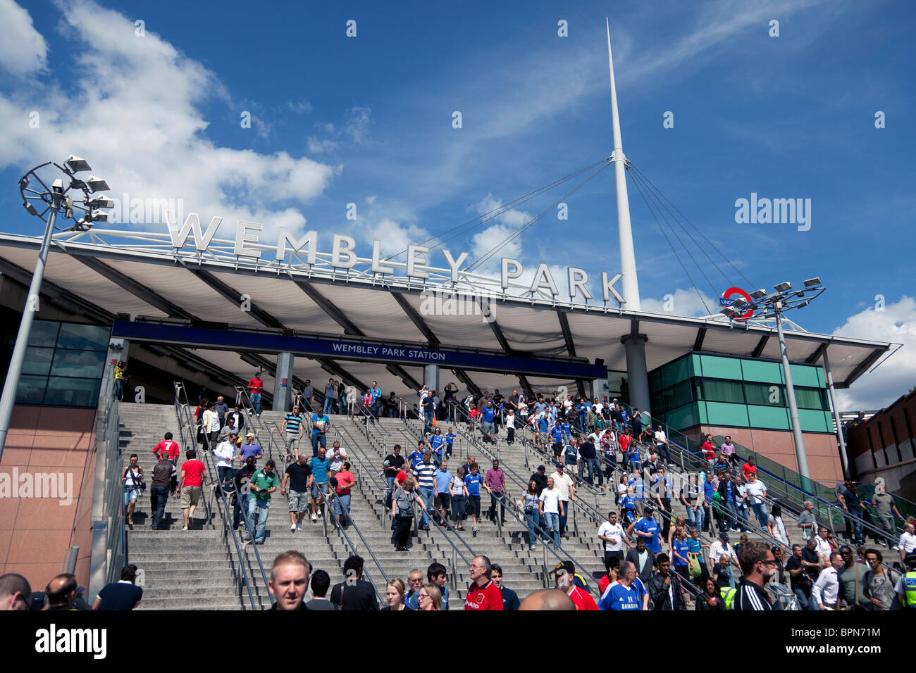 Football Supporters at Wembley Park Underground Station - Stock Image