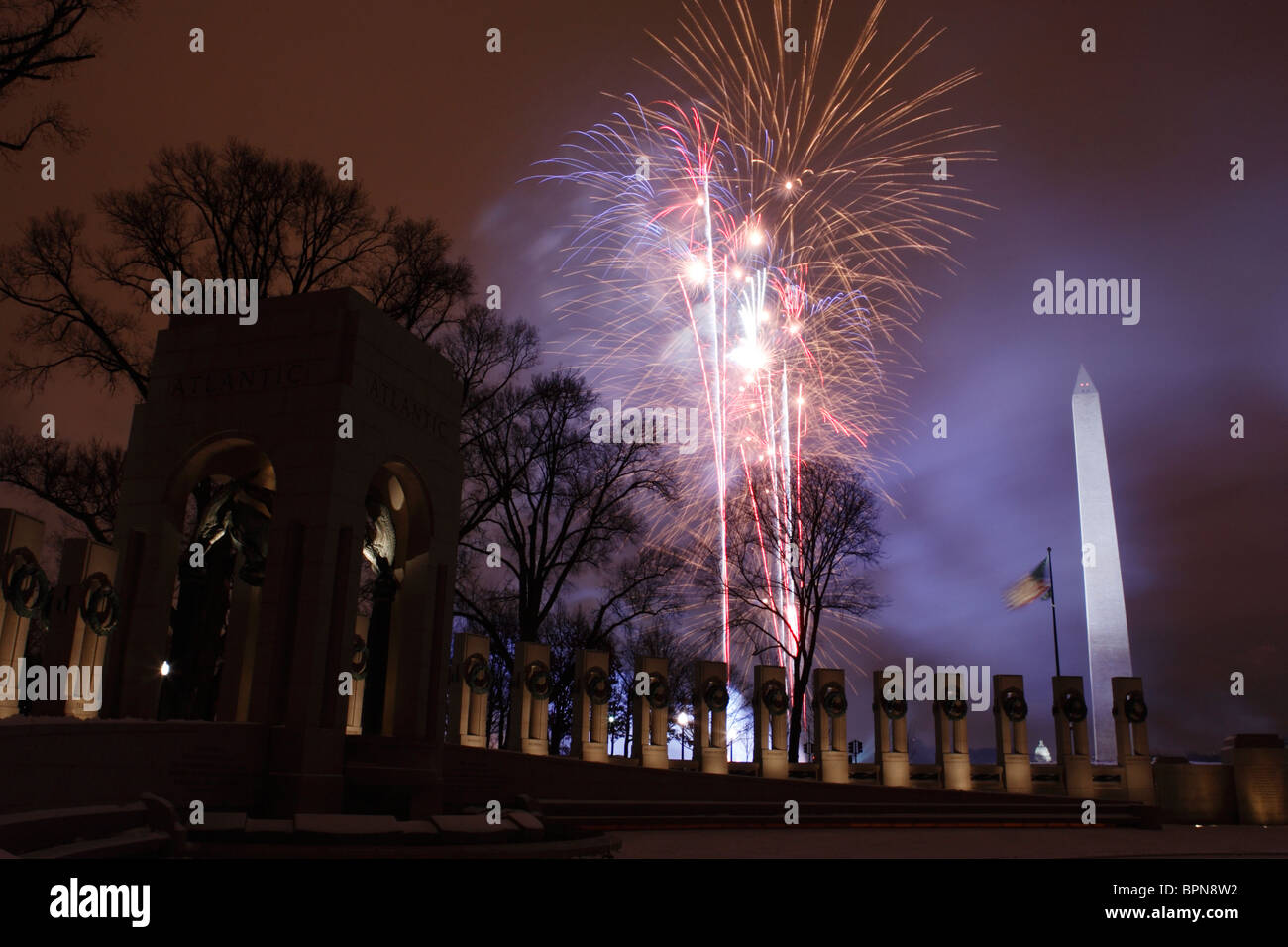 Fireworks are launched near the World War II Memorial to commemorate George W. Bush's second inauguration as - Stock Image