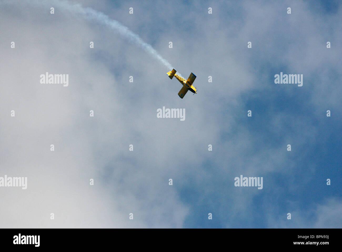 A Fuji FA200 Aero Subaru single engine aerobatic plane performing aerobatics with a smoke trail - Stock Image