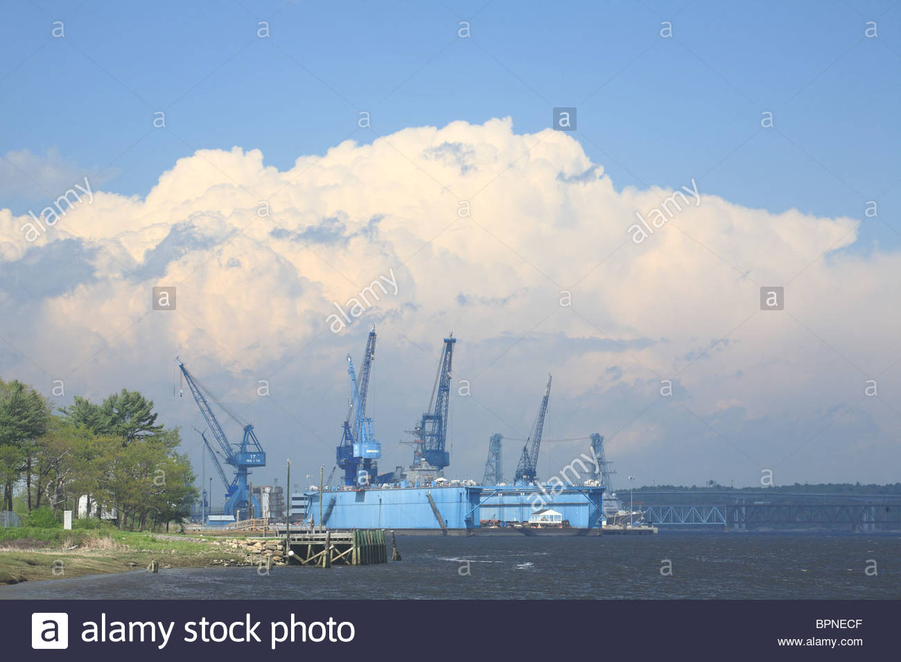 View of Bath Iron Works, a shipbuilding company on the Kennebec River in Bath, Maine, USA. Stock Photo