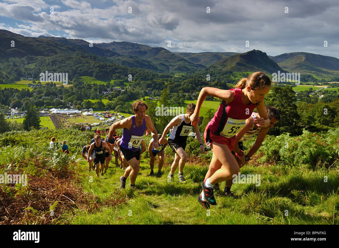 Fellrunners on the way up to Butter Crag in the Grasmere Senior Guides Race at the 2010 Grasmere Show - Stock Image