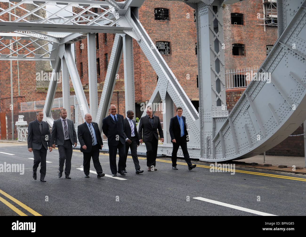 Dignitaries walking across the Bascule Bridge after the opening ceremony performed by Joe Anderson and Ian Porritt. - Stock Image