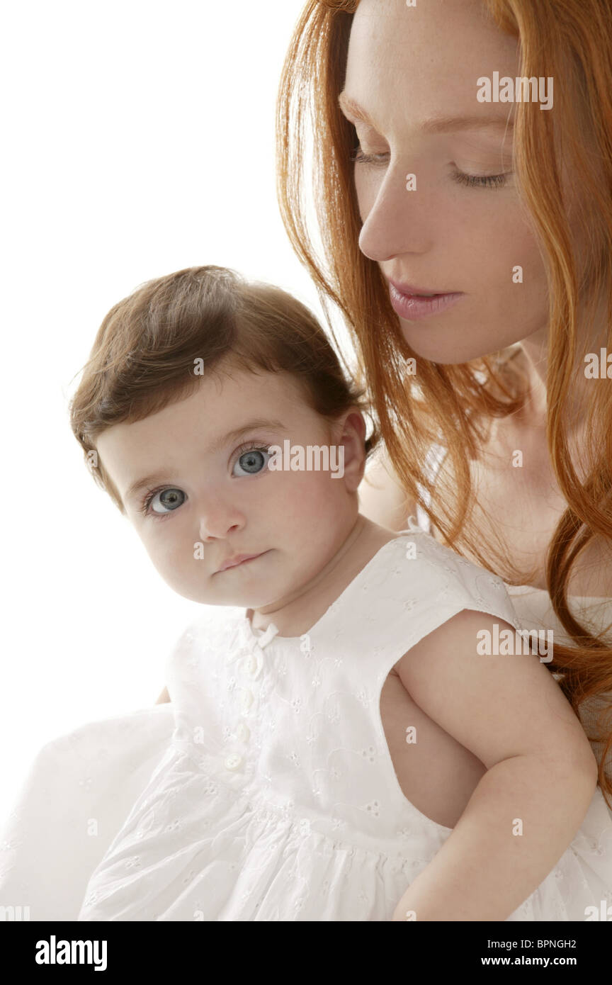 Baby and mom in love hug over white studio background