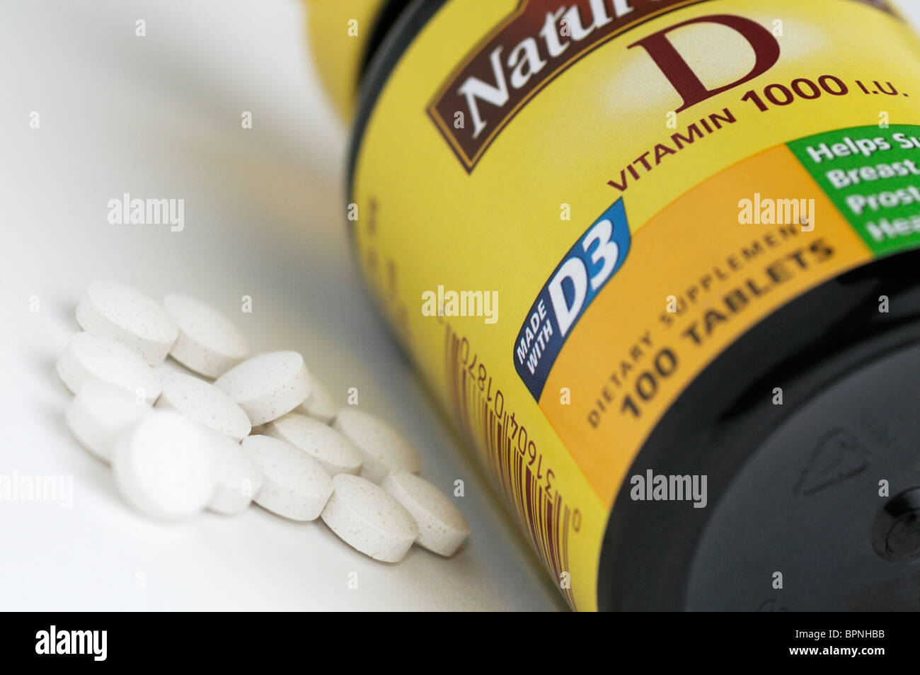 Bottle of vitamin D (D3) supplements - Stock Image