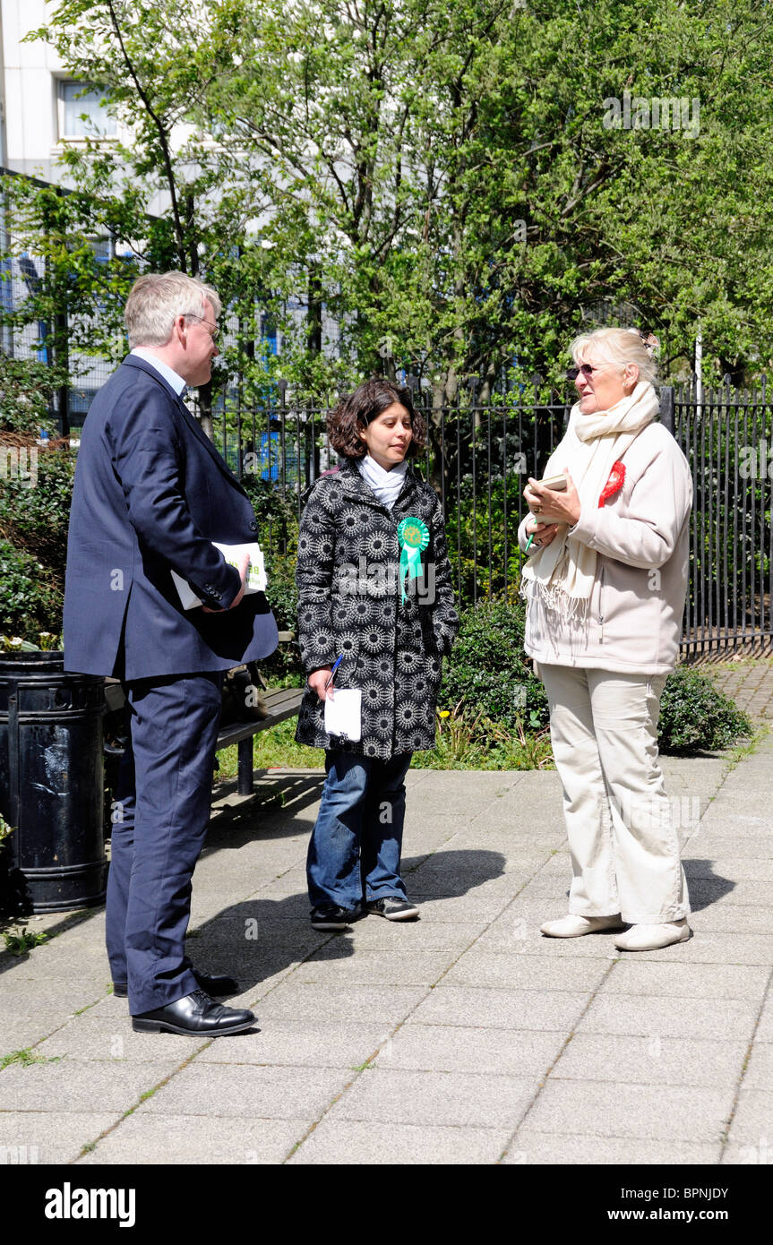 Green and Labour Party tellers outside Polling Station Holloway London England UK - Stock Image