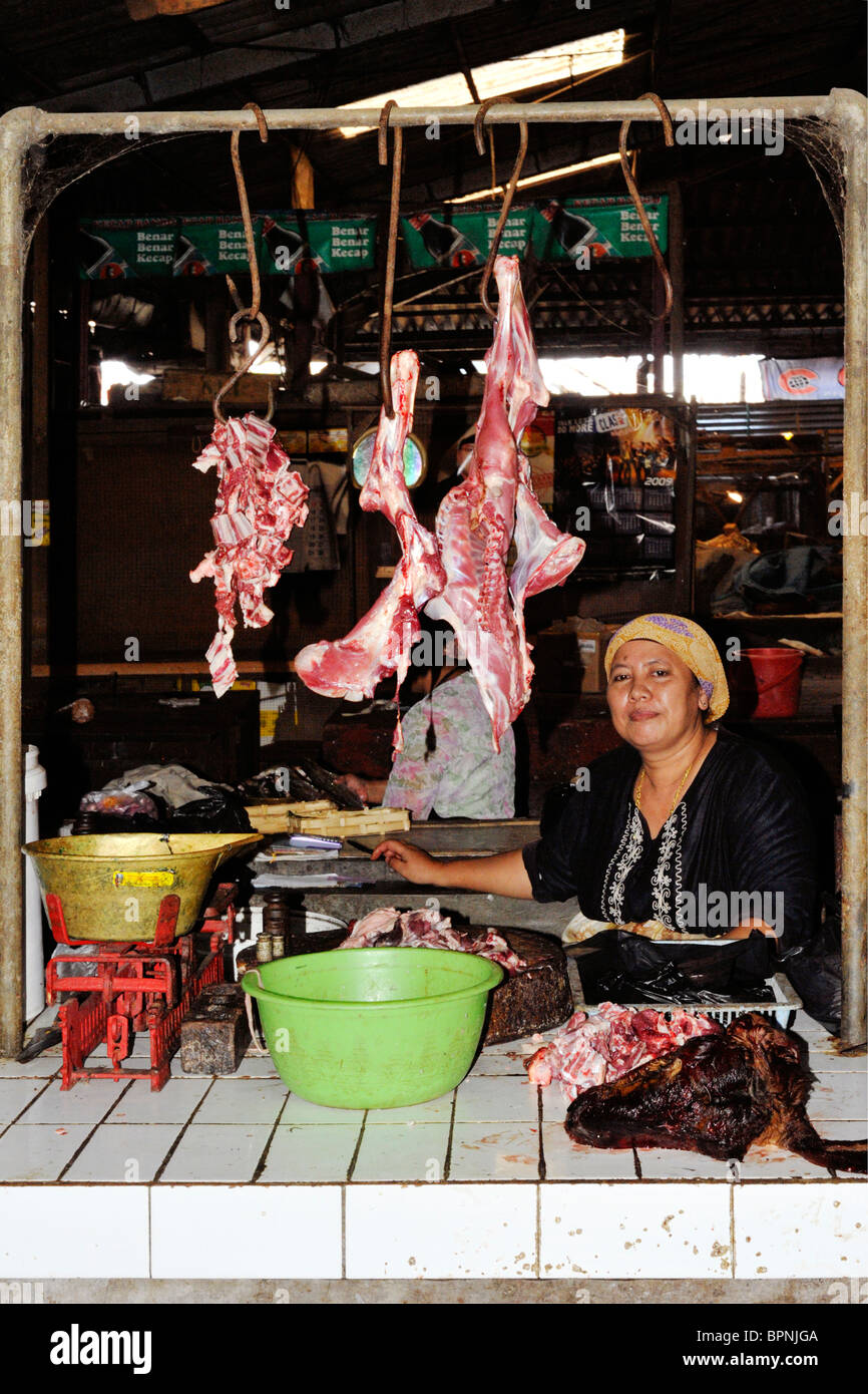 female stall holder selling meat in malang market java indonesia - Stock Image