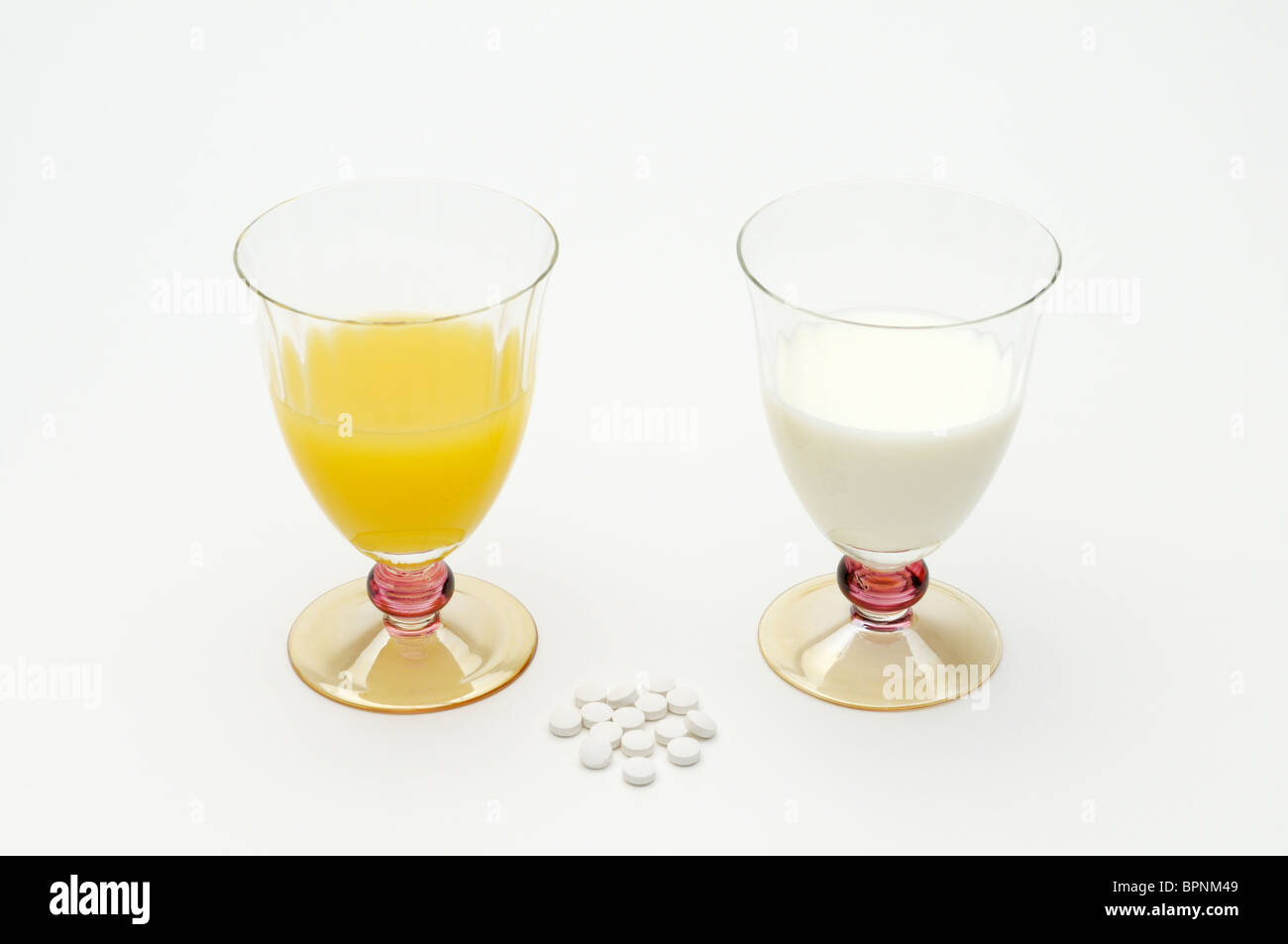 Sources of vitamin D include milk, orange juice and supplements. - Stock Image