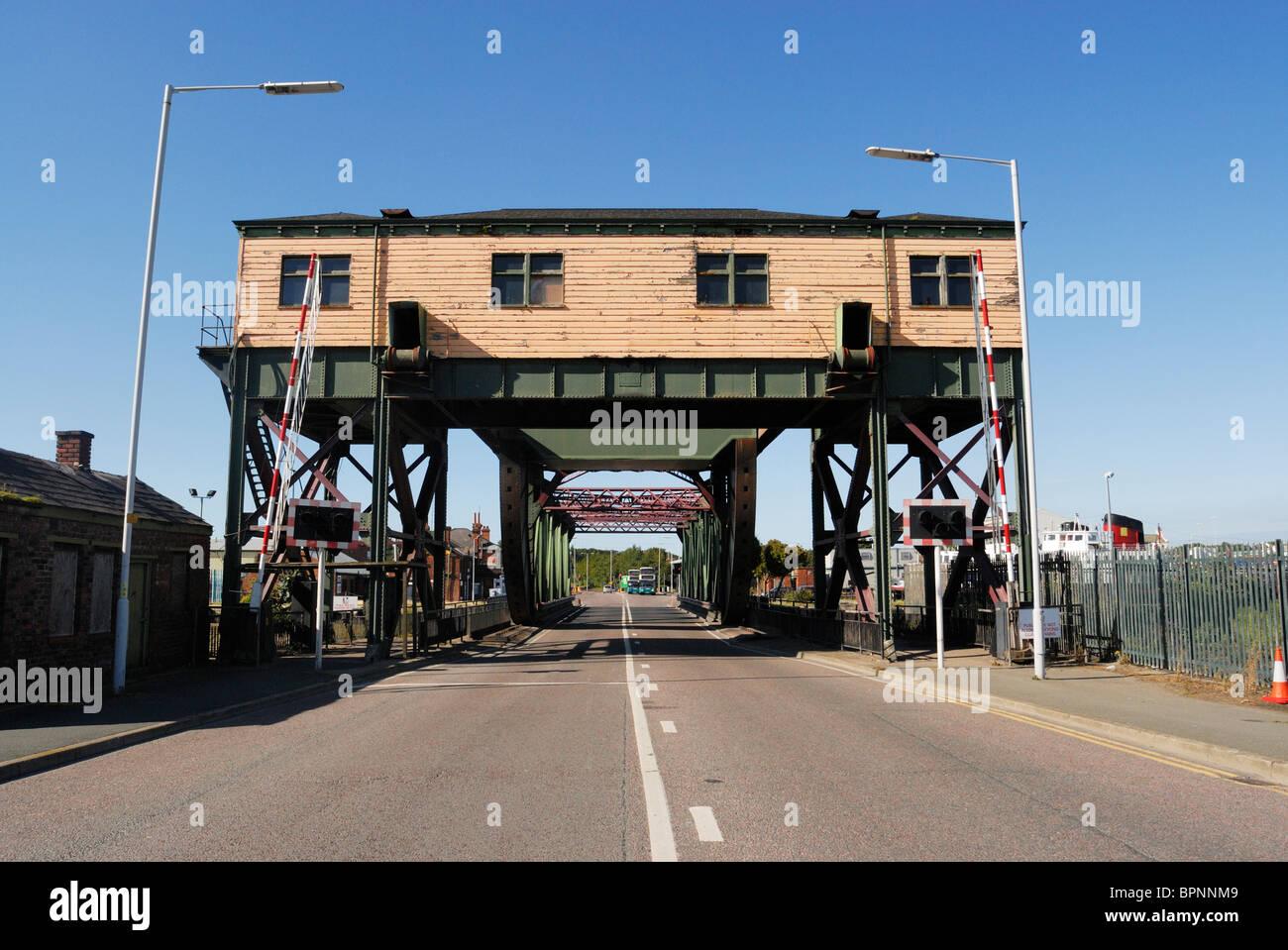 Rolling bascule lift bridge between the East and West Floats. Birkenhead Docks. - Stock Image