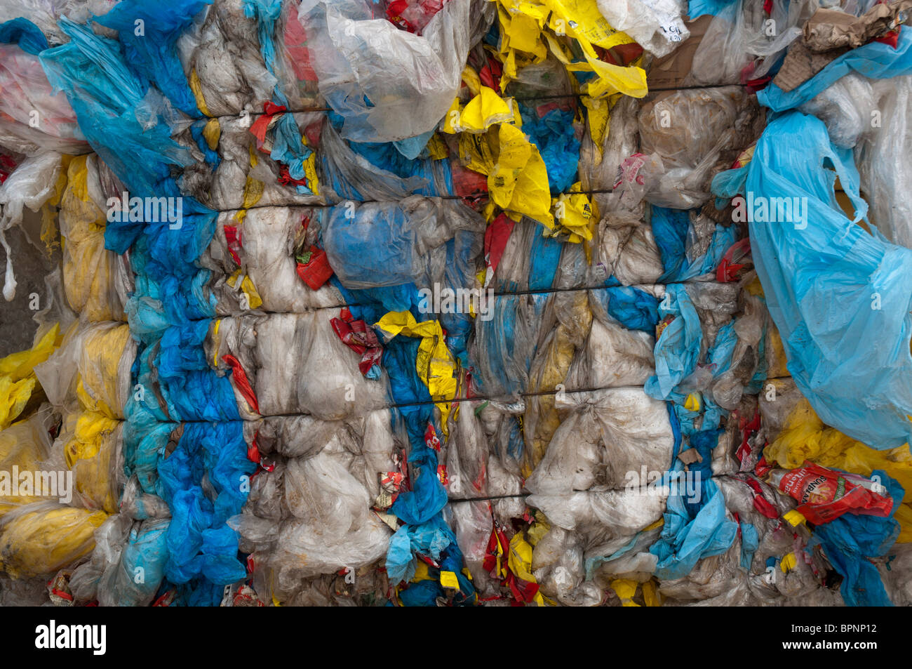 Baled plastic bags for recycling at a recycling plant - Stock Image