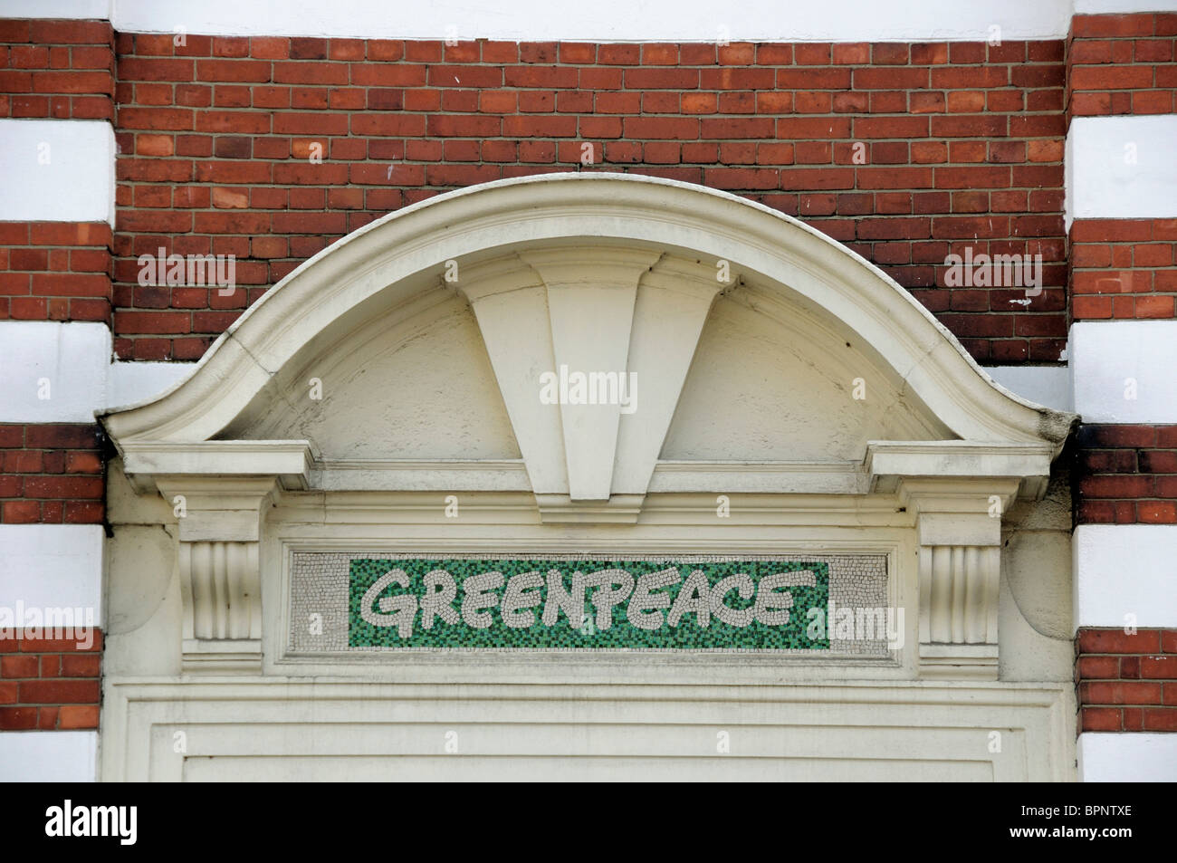 Sign above Greenpeace's office, Canonbury London Borough of Islington England Britain UK - Stock Image