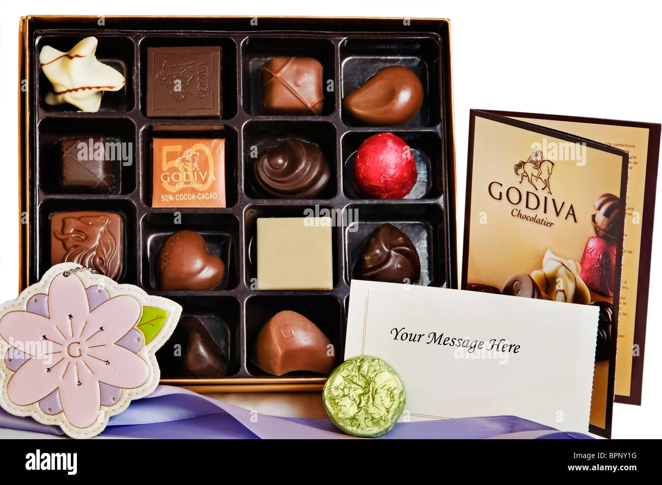 An open gift box of gourmet Godiva chocolates and truffles displayed after being unwrapped. Stock Photo