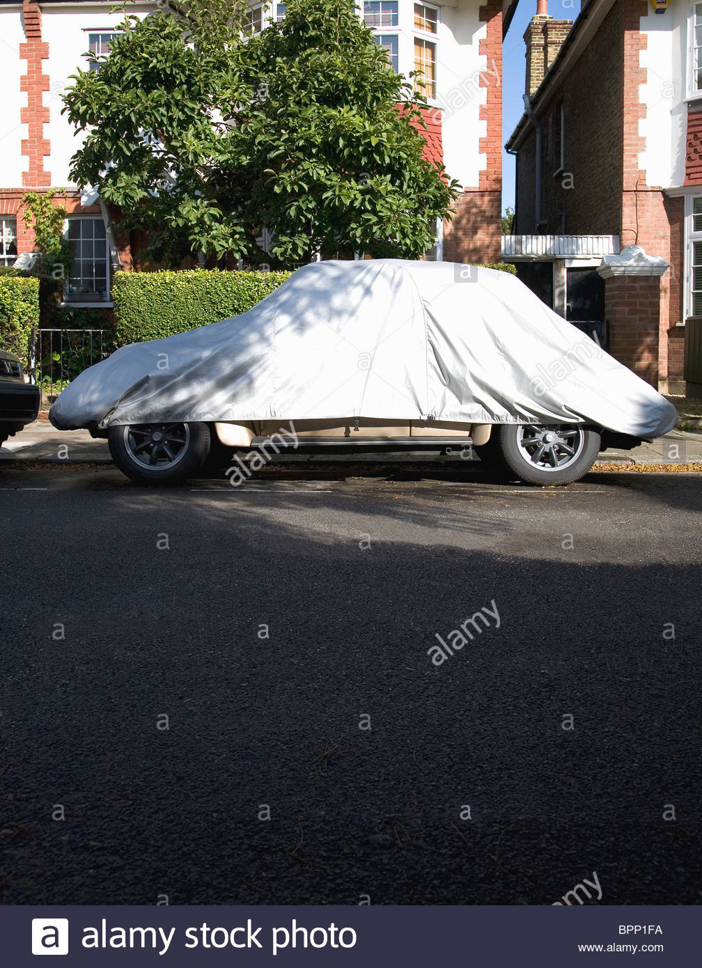 Car covered with car cover - Stock Image