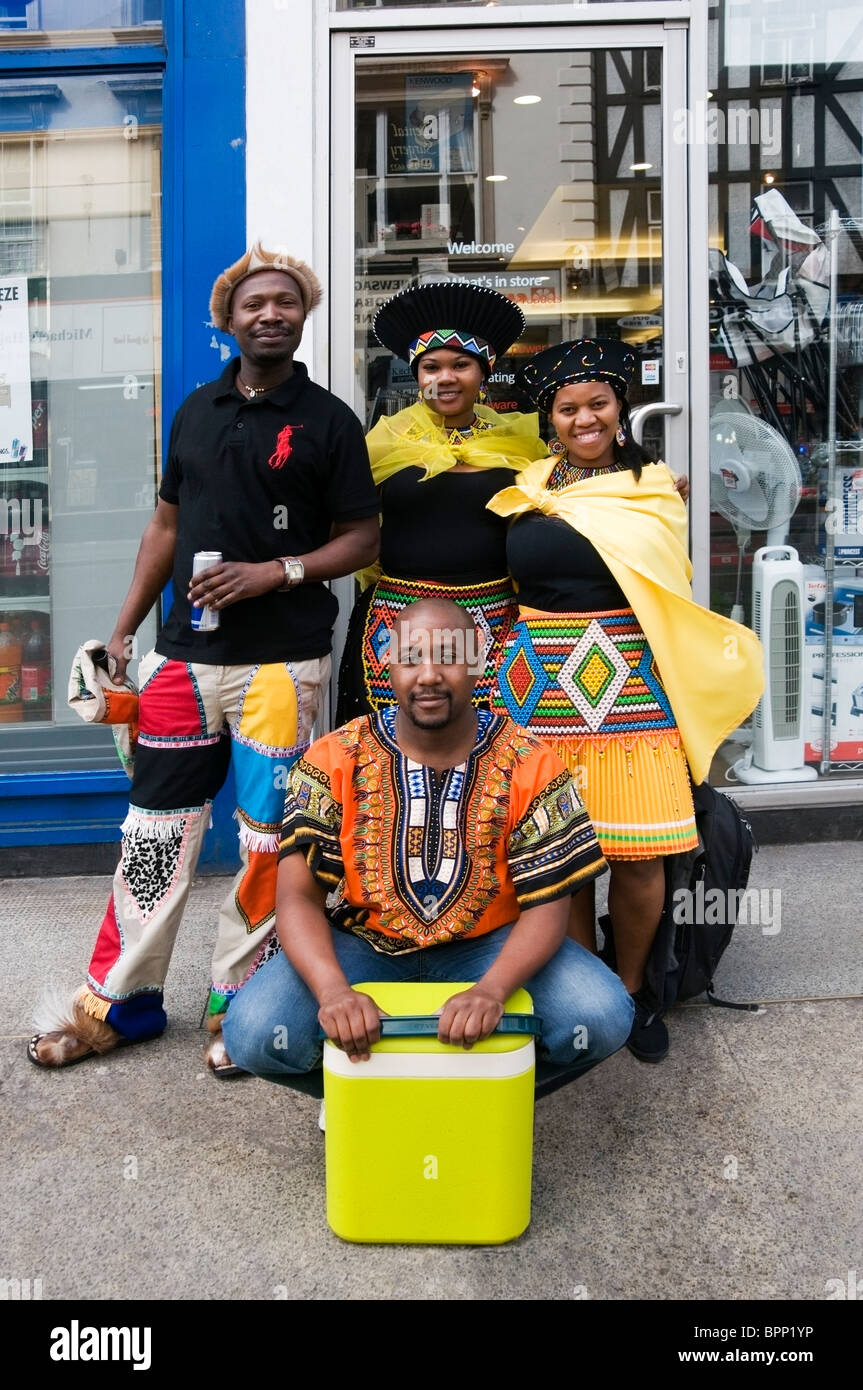 Portrait of African four friends ready for picnic at Notting Hill carnival 2010, London, England, UK, Europe, EU - Stock Image