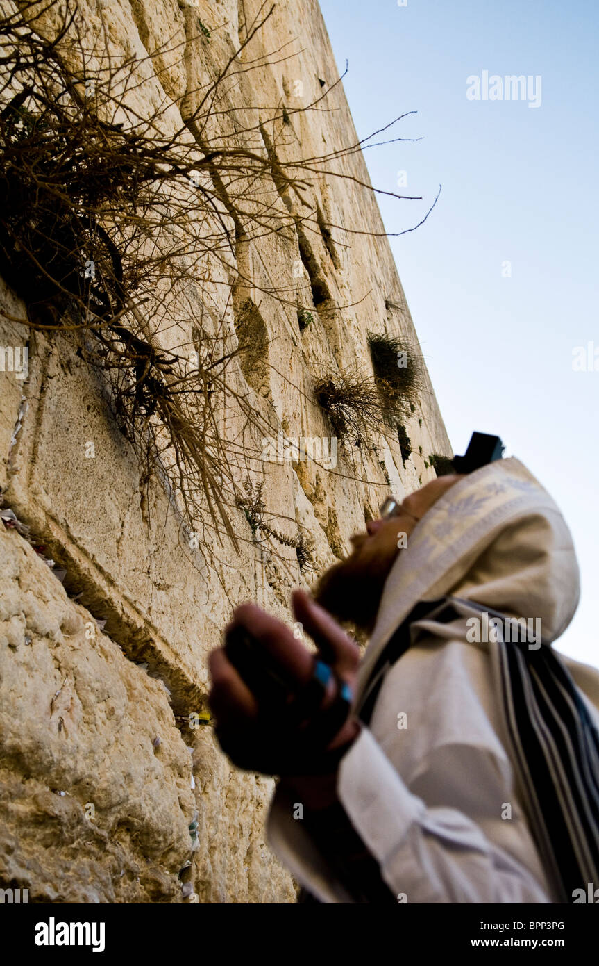 A Jewish man praying by the wailing wall in the old city of Jerusalem. - Stock Image