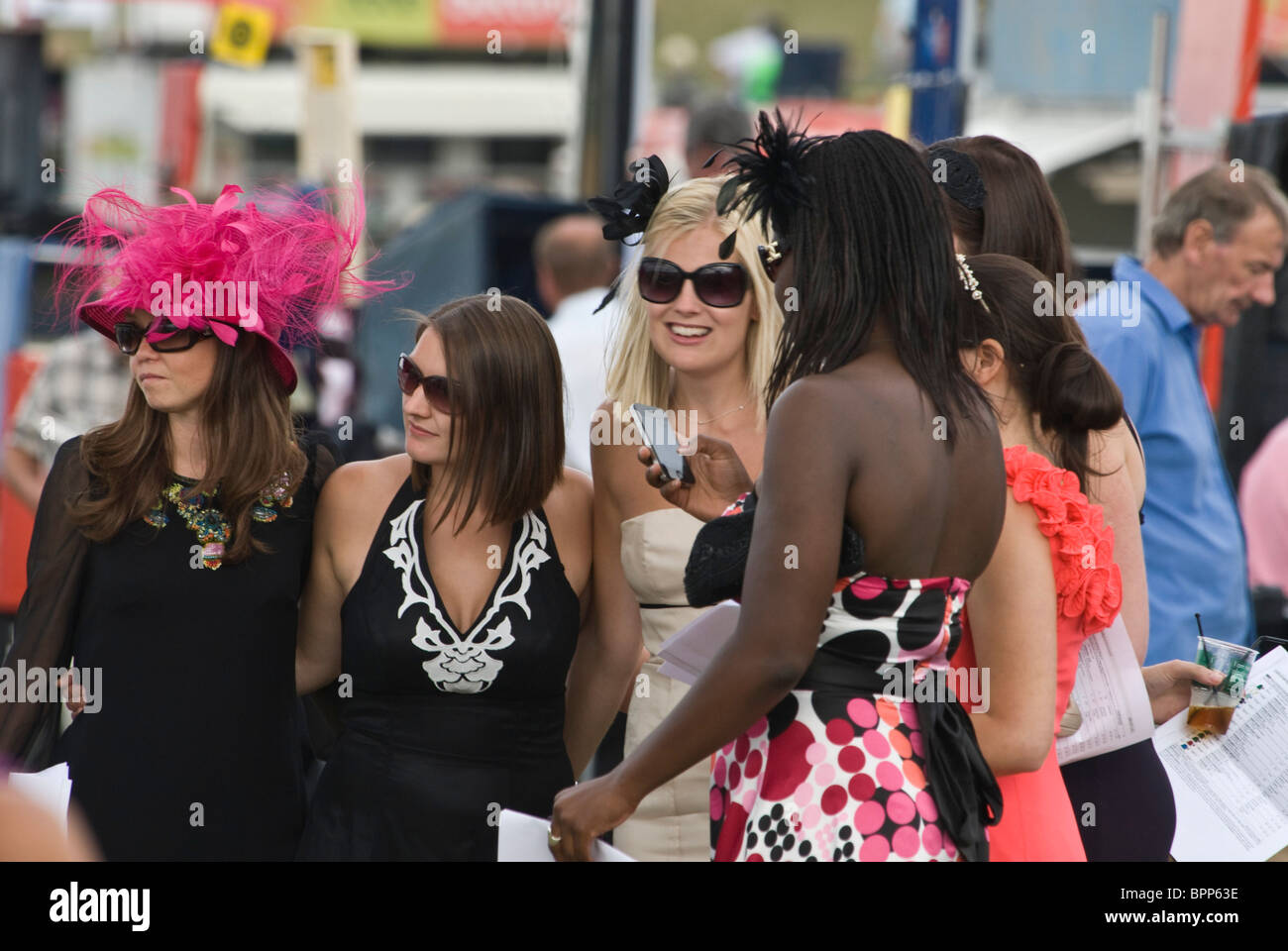 Young women dressed for Ladies' Day, Glorious Goodwood horse racing 29th July 2010. - Stock Image
