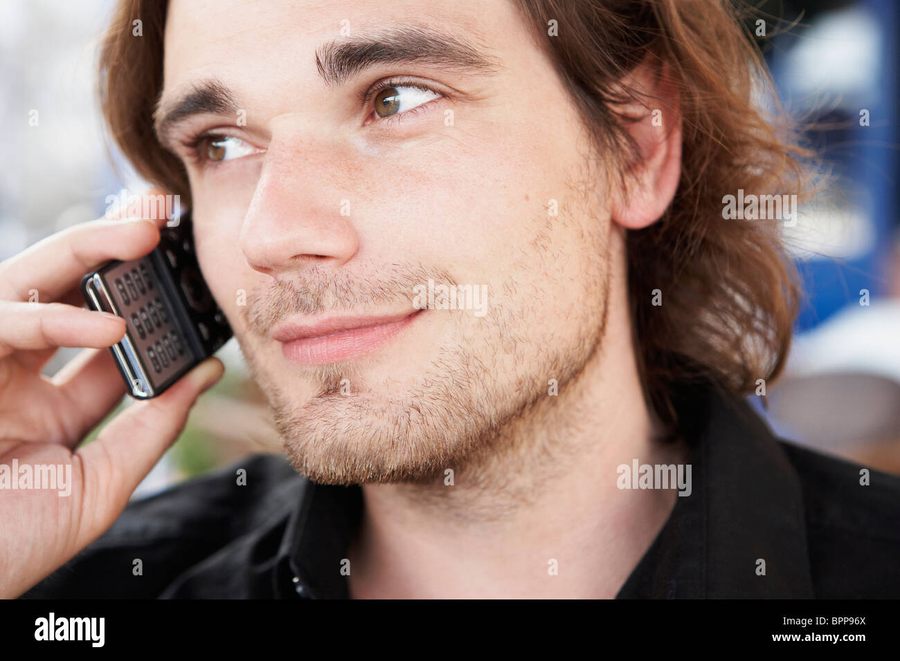 Young man phoning - Stock Image