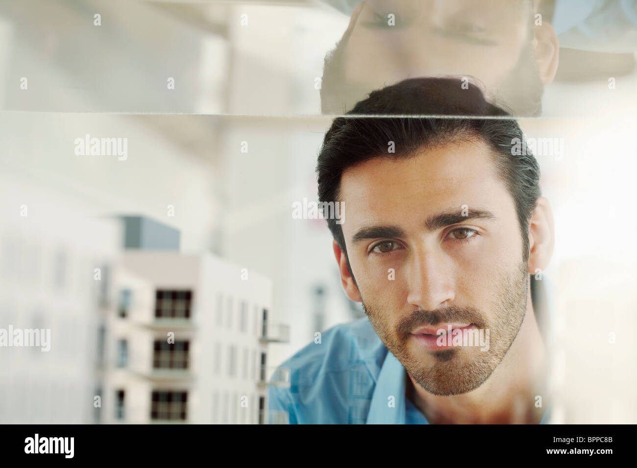 Young man with architectural model - Stock Image