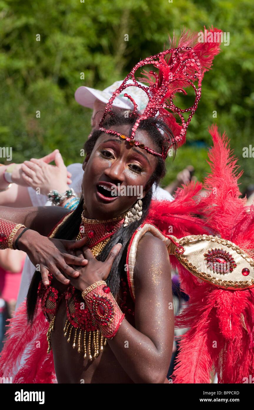 Caribbean Carnival Costume Red Stock Photos & Caribbean Carnival