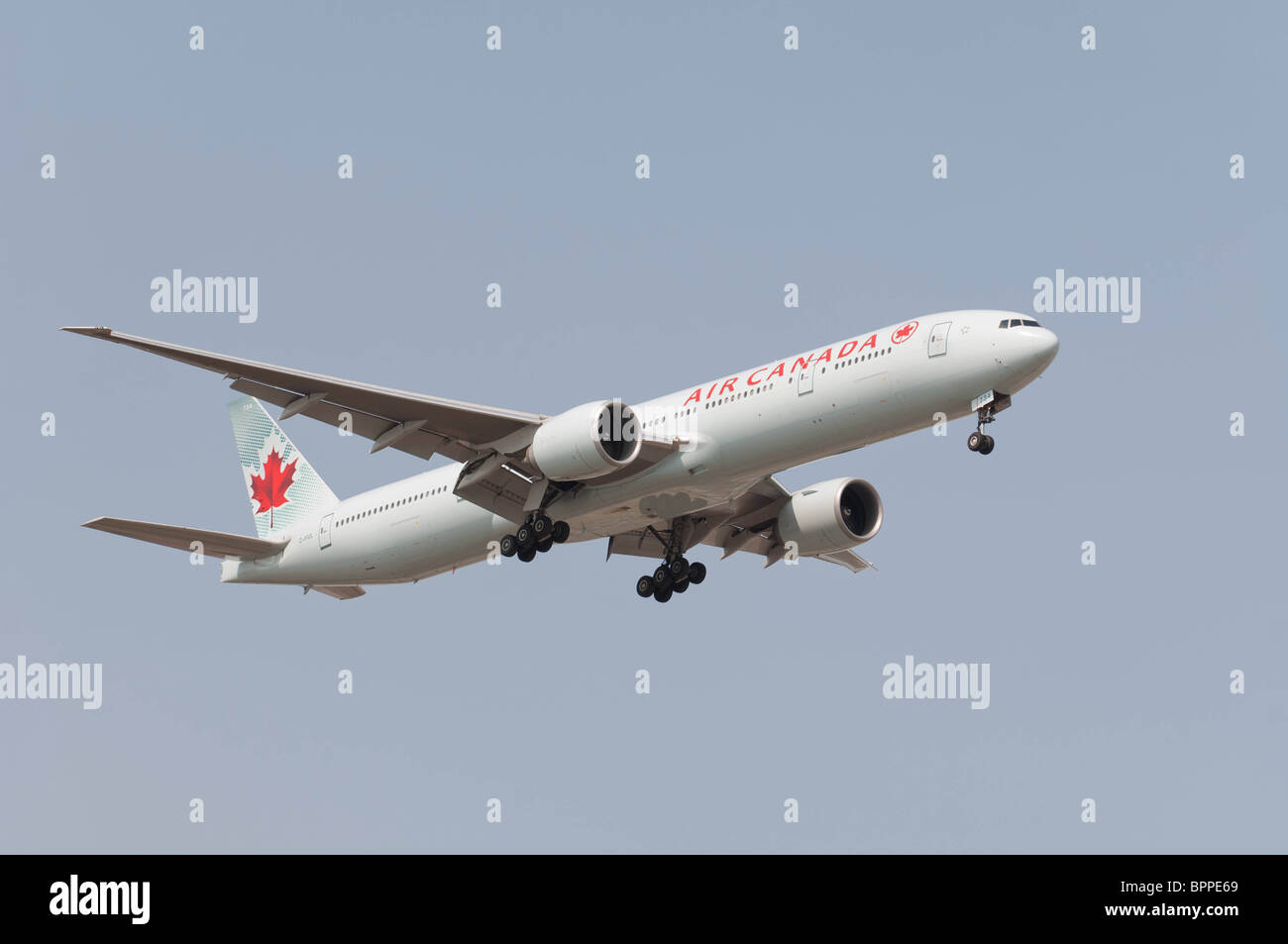 Air Canada Boeing 777-333/ER on final approach to Lester B. Pearson International Airport. - Stock Image