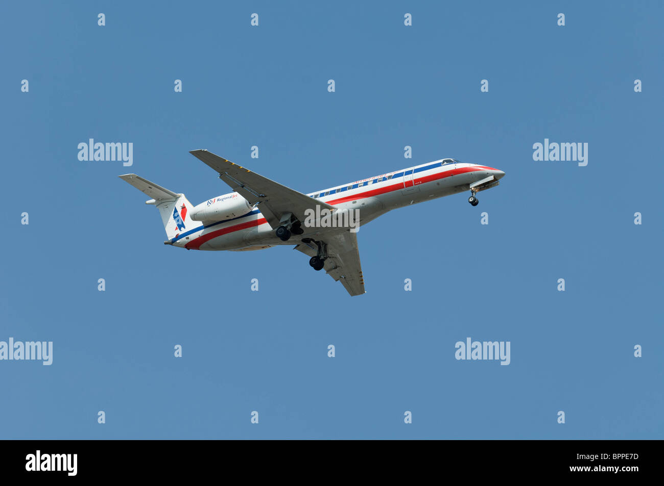 American Eagle Embraer ERJ-135LR on final approach to a runway. - Stock Image