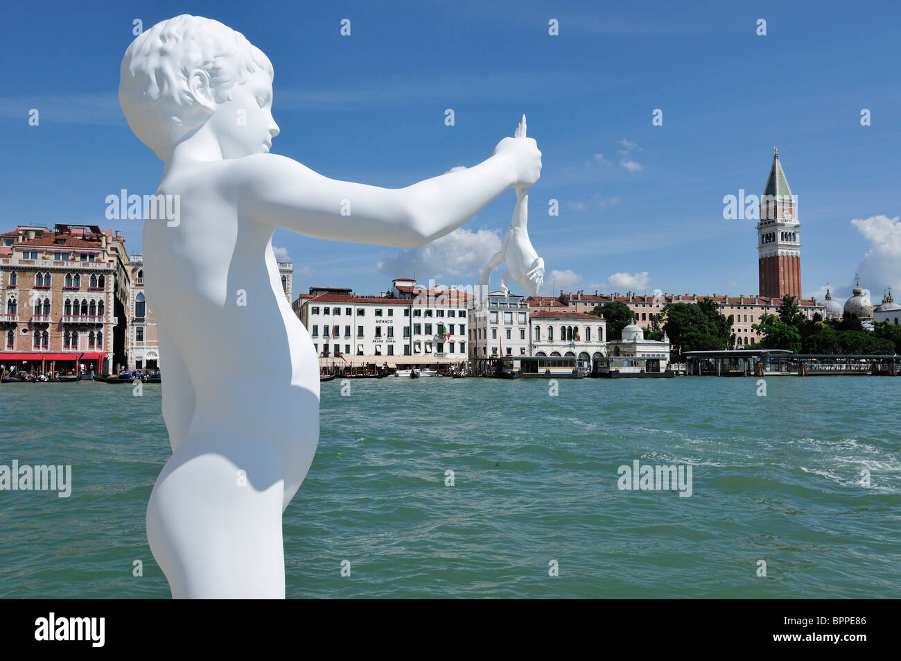 Venice. Italy. Boy with a Frog by the artist Charles Ray on the Punta della Dogana - Stock Image