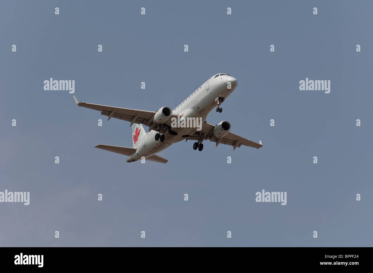 Air Canada Embraer 170-200LR on final approach to landing. - Stock Image