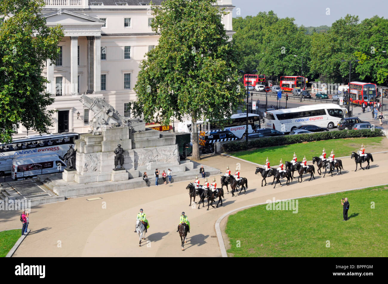 Hyde Park Corner Household Cavalry passing the Royal Artillery Memorial and the Lanesborough Hotel Stock Photo