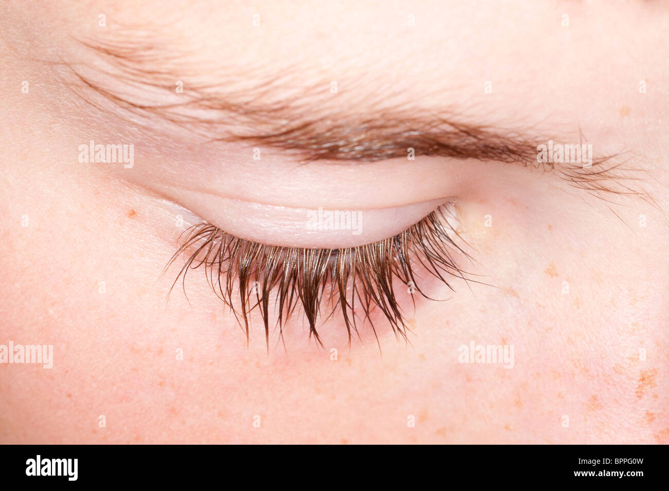 A close up of ten year old boys eyelash in the Uk - Stock Image