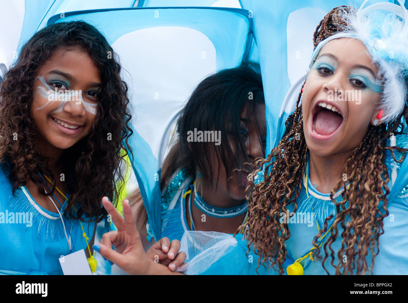Girls in costume having fun at the Notting Hill Carnival (2010), London, England - Stock Image