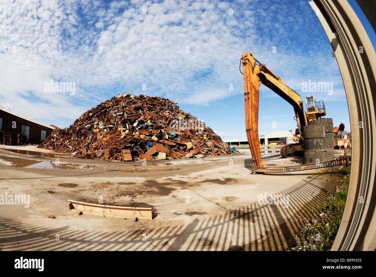 Scrap metal piled up on Liverpool Docks ready to be exported. - Stock Image