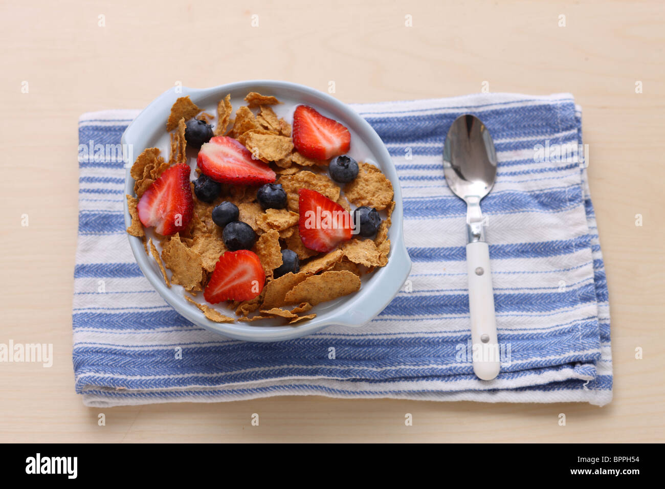 Cereal with strawberries and blueberries - Stock Image